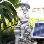 boy solar pond spitter